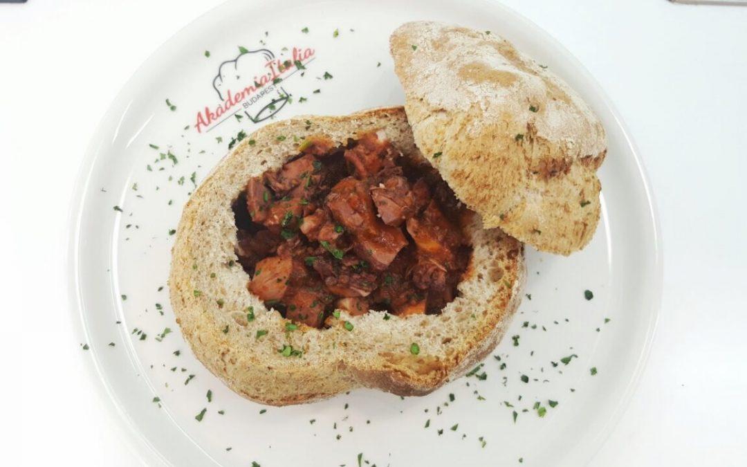 Polipo al vino rosso in coccio di pane